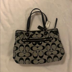 NEW coach purse. Perfect condition. Black print.